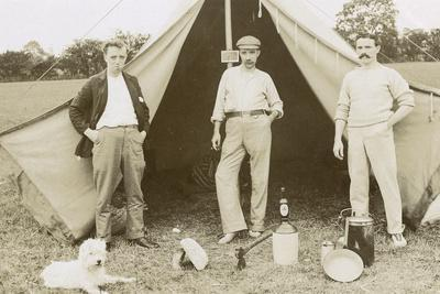 Three Men Camping with a Dog