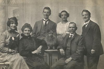 Family Group Studio Portrait with Small Dog