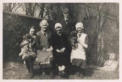 Family Group with Two Dogs in a Garden