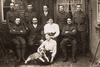 Group Photo with Soldiers and Dog in Yard