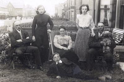 Family of Six with a Dog in a Front Garden