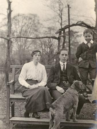 Family Group with a Dog in a Garden
