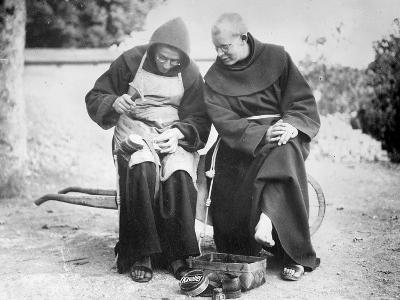 Monks Mending Sandals