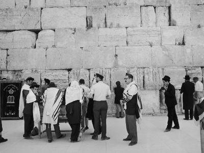 Jewish Men in Various Modes of Traditional Dress at the Wailing Wall in Jerusalem
