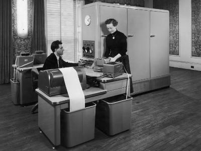 Man and a Women Working Together with a Pegasus Computer