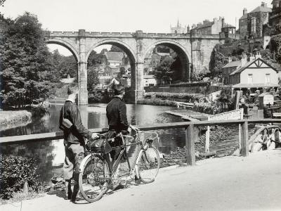 Two Cyclists Take a Break on a Bridge Over the River Nidd at Knaresborough
