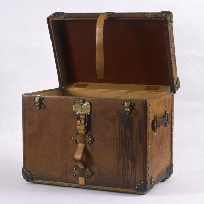 A Large Leather-Bound Trunk with Straps, Buckles and Locks
