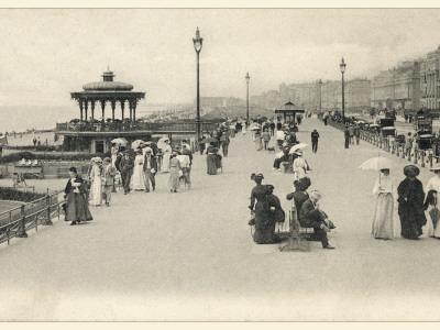 Parasols are Carried by Many Holidaymakers on the Promenade at Brighton