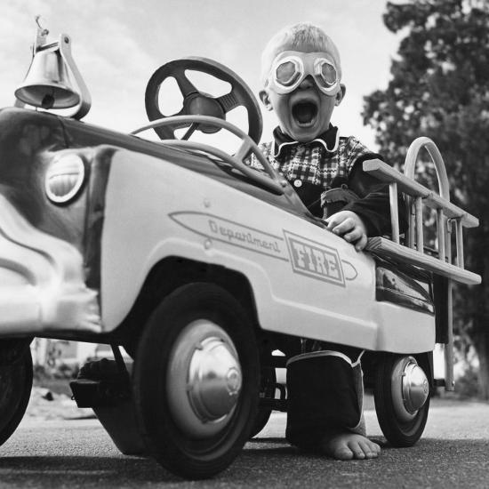 Young Boy Playing With Toy Fire Truck Photographic Print