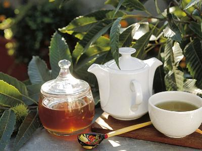 Close-Up of a Teapot with Herbal Tea and Honey