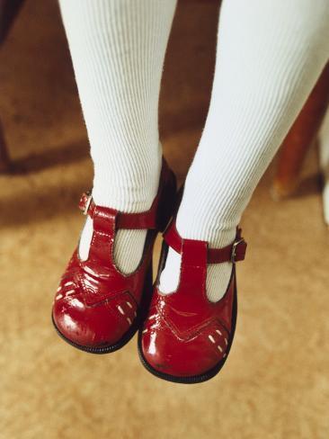Feet of a Little Girl Wearing Shiny