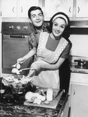 Couple Standing in Kitchen, Smiling