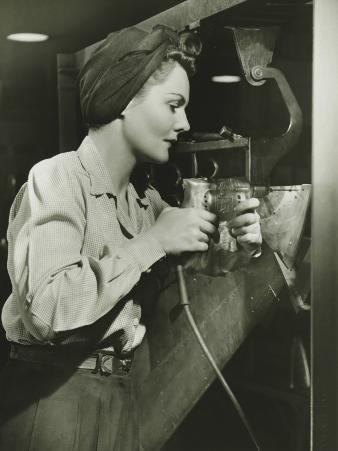 Woman Working With Electric Drill in Factory