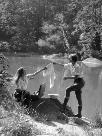Two Women Camping By Lake Washing Clothes