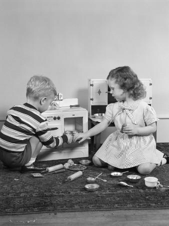 Boy and Girl Playing House With Toy Stove