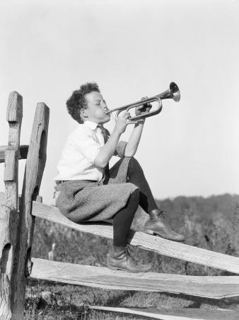 Boy Sitting on Fence, Playing Musical Instrument