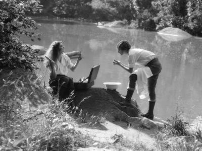Two Women Camping By Lake