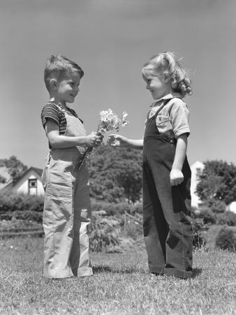 Boy Giving Bouquet of Daisies To Little Girl