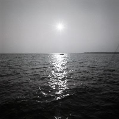 Distant Boat on Ocean