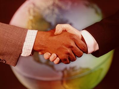 Handshake in Front of Globe