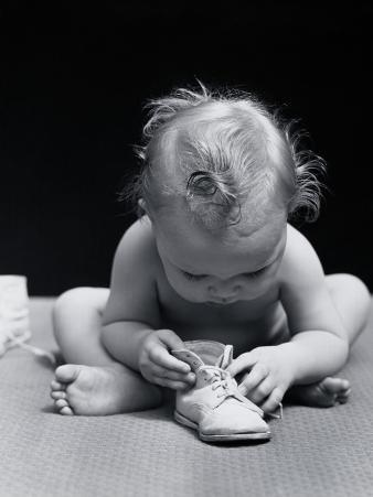 Baby Leaning Over Playing With Shoe
