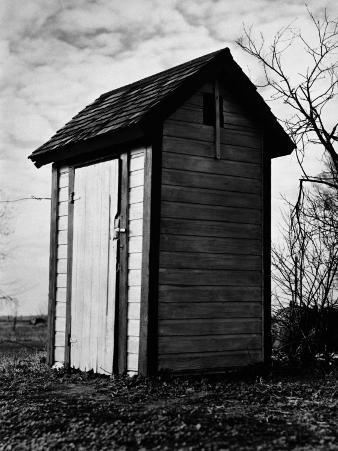 Small Run-Down Outhouse in Middle of Countryside