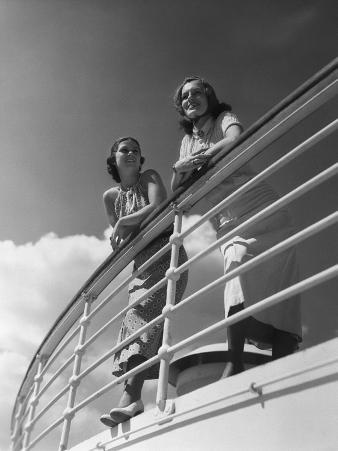 Two Women Standing By Railing on Cruise Ship