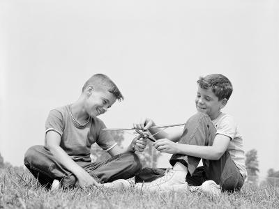 Boys Playing With Toy Plane