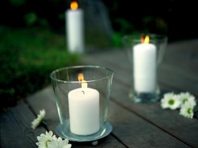 Lit Candles in Glass Candleholders