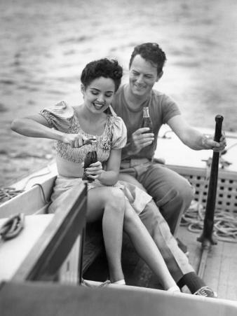 Couple on Small Sail-Boat Drinking Coke