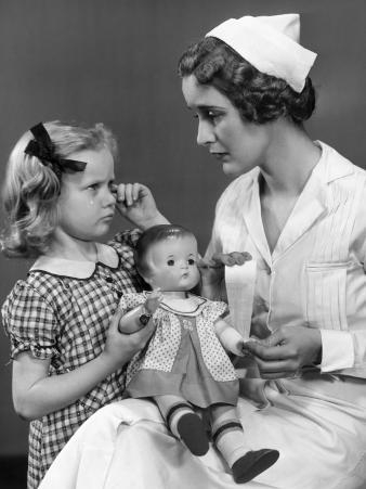 Nurse Consoling Young Girl and Her Doll