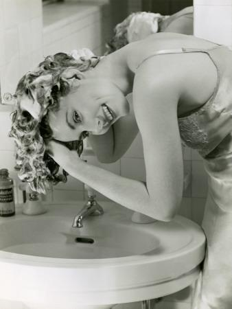 Woman Washing Her Hair in Sink