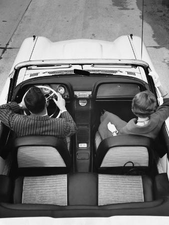 Couple Driving in Convertible