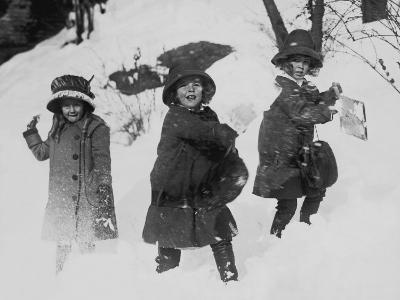 Three Girls in Winter Coats, Playing in the Snow
