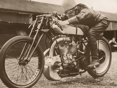 Man Sitting on Vintage Motorcycle