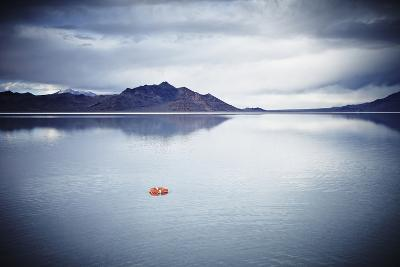 Life Ring Floating on Water under Stormy Sky