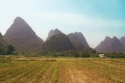 Colossal Mountains in a Farmland