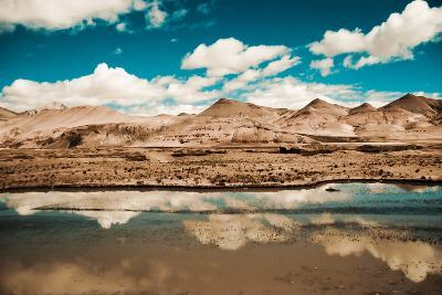Clouds Reflected in a Lake. Tibet Landscape