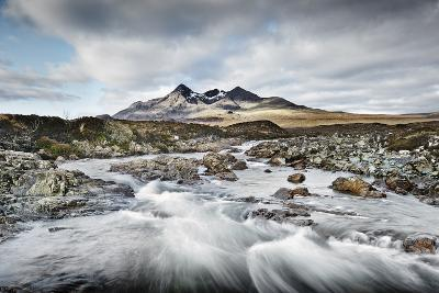 Mountain Range Seen from Fast Flowing River