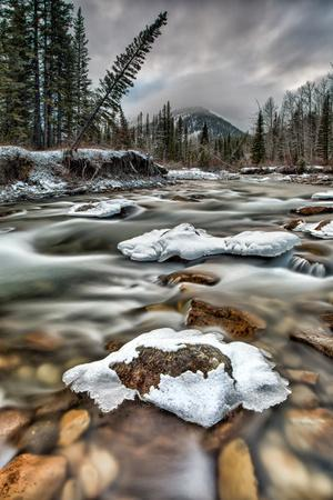 Mountain River Flows through Winter Landscape