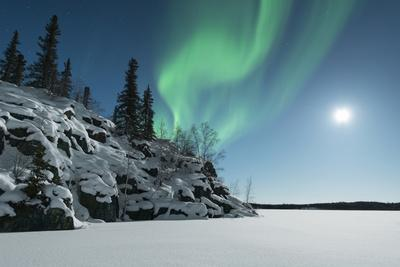 Aurora over Small Snow Covered Hill