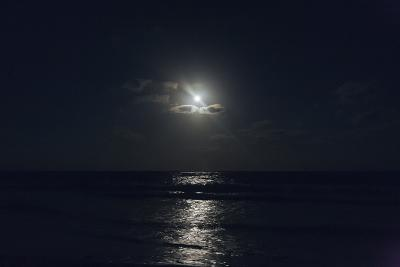 Full Moon through Clouds over the Ocean