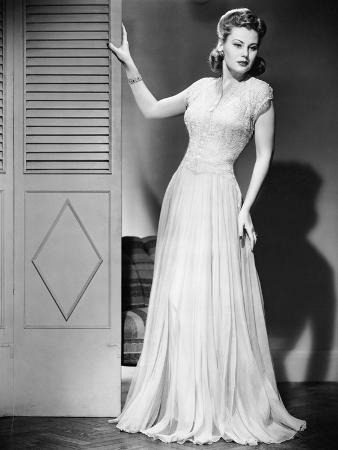 Woman in Evening Dress Posing next to Door