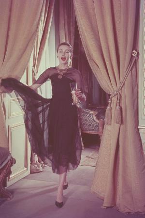 WOMAN ENTERING Room, Drink, SWINGING SKIRT