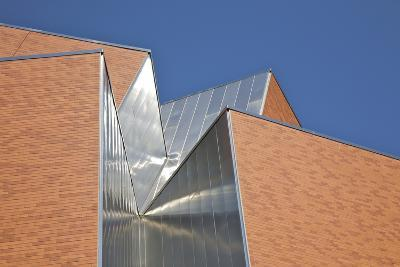 Detail of Aluminum and Brick against Blue Sky.