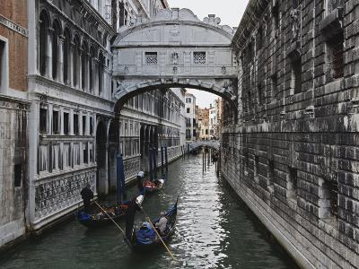 Historic Bridge of Sighs and Gondolas in Canal, Venice, Italy