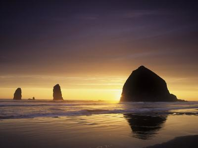 Haystack Rock and Other Sea Stacks Silhouetted at Sunset, Cannon Beach, Oregon, USA