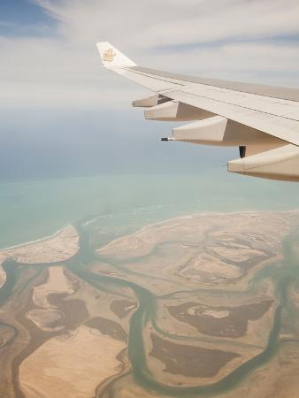 Flying over the Coastline and Estuary of Dubai in the Uae