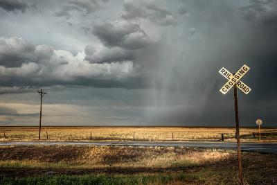 Rural Landscape with Dramatic Sky over Railway Crossing in America