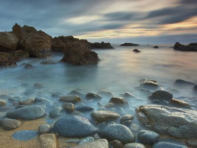 Waves Eroding the Rocks and Cobblestones on the Rocky Big Sur Coast of Central California, USA